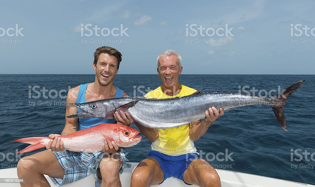 Father And Son With Their Catch stock photo