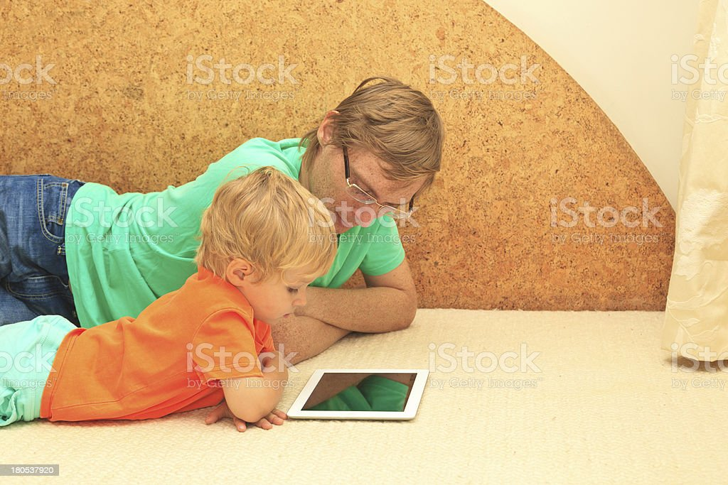 father and son working from home royalty-free stock photo