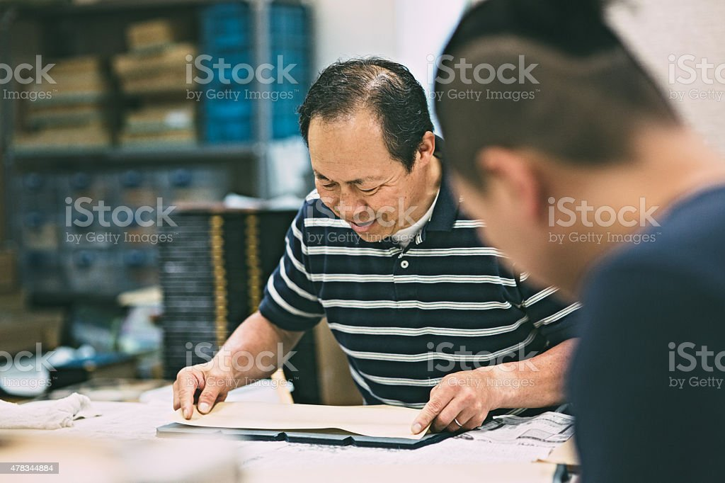 Father and son works on the art and craft product stock photo