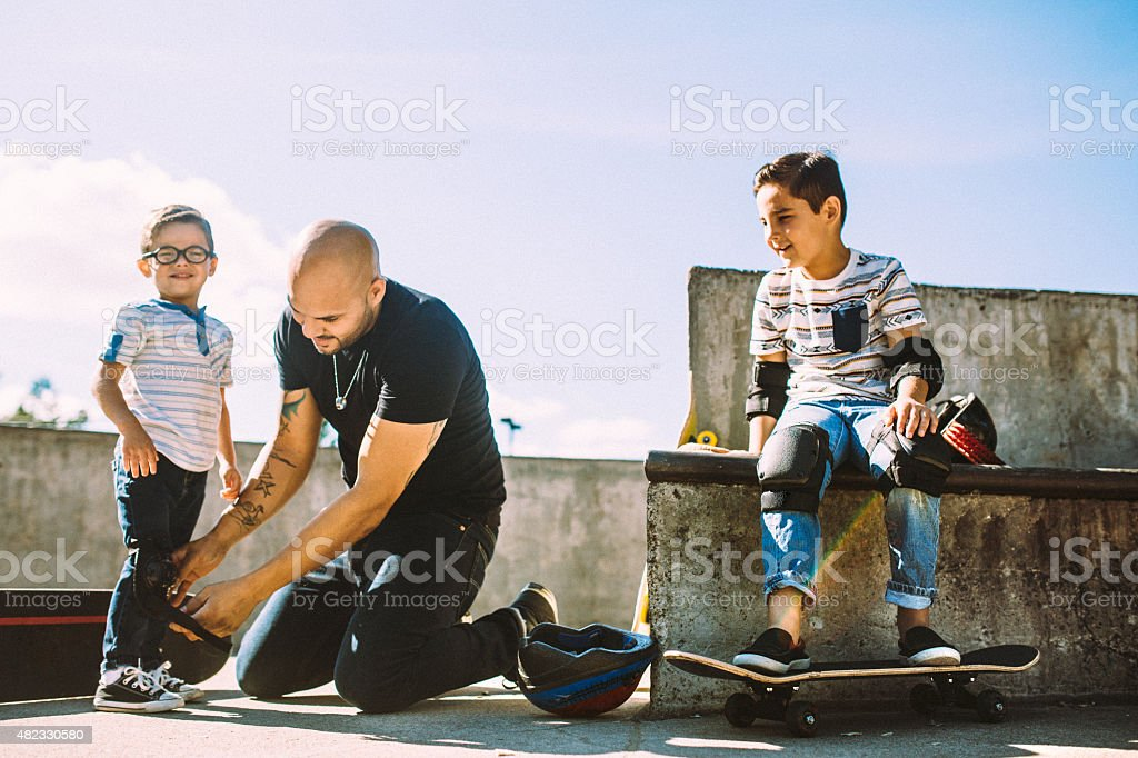 Father and Sons at Skate Park stock photo