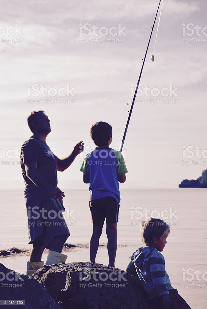 Father and Sons Fishing stock photo