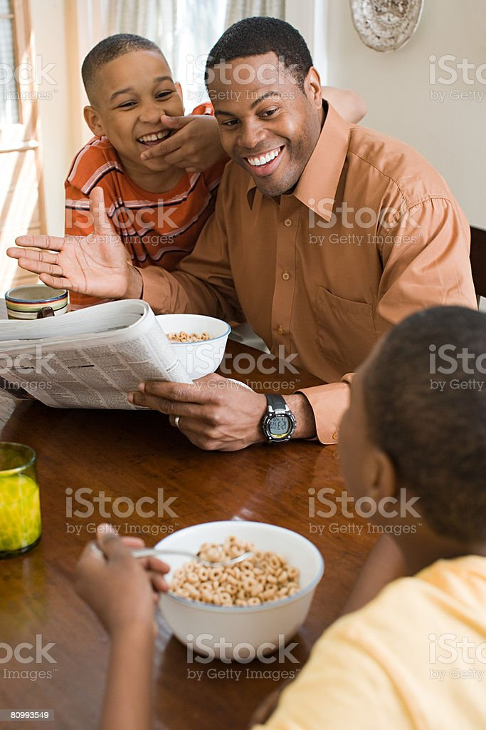 Father and sons having breakfast royalty-free stock photo