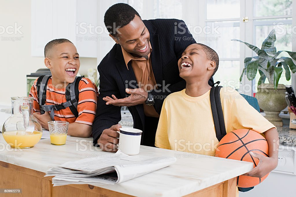 Father and sons laughing stock photo