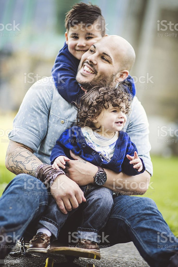 Father and Sons on Skateboard stock photo