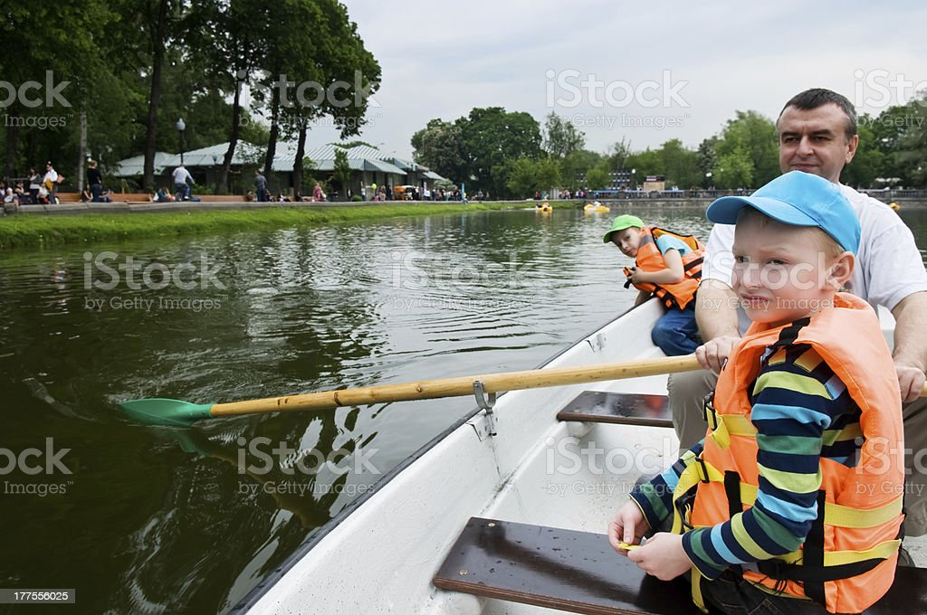 father and sons on the boat royalty-free stock photo