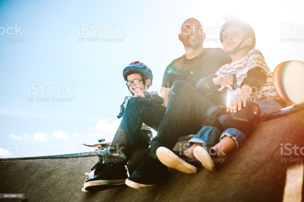 Father and Sons Skateboarding stock photo
