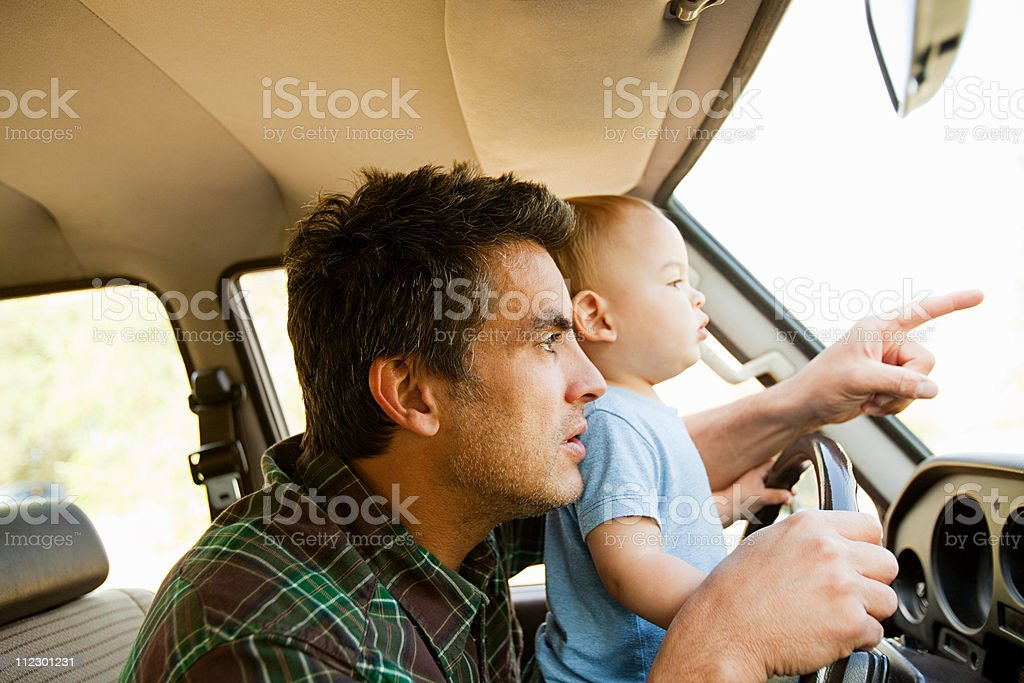 Father and young son in a car royalty-free stock photo