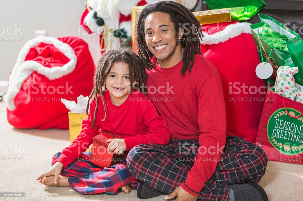 Father and young son with dreadlocks at Christmas stock photo
