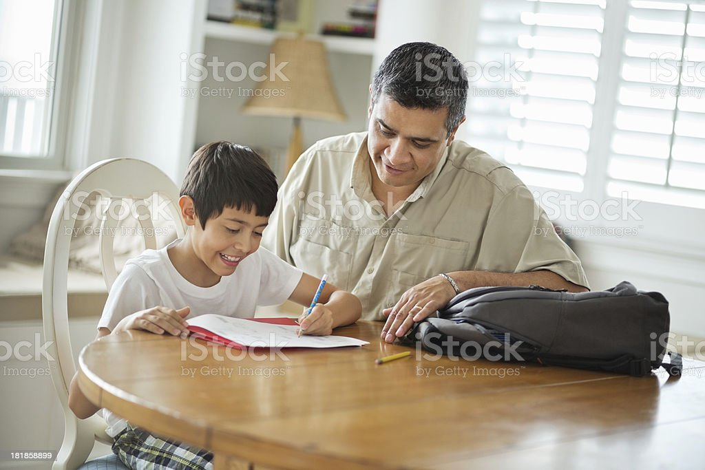 Father Assisting Son With Studies royalty-free stock photo