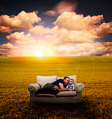 Father & Baby on Couch in Field
