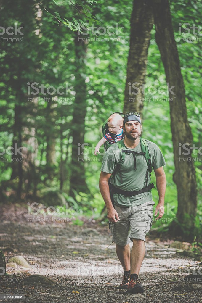 Father Backpacking Hiking with Baby in Forest stock photo