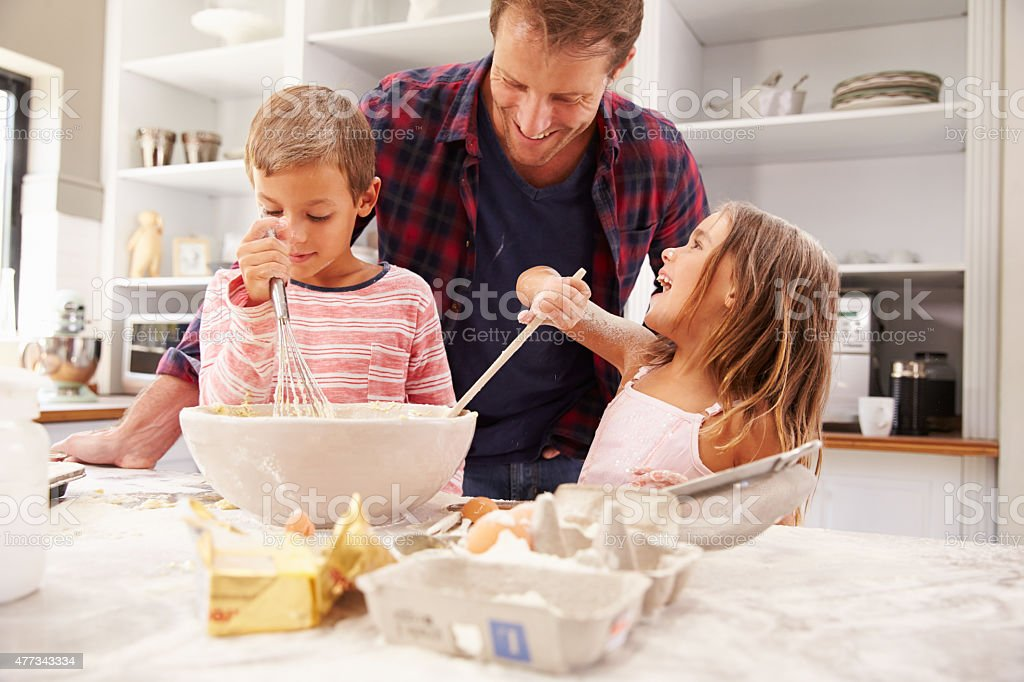 Father baking with children. Having fun stock photo