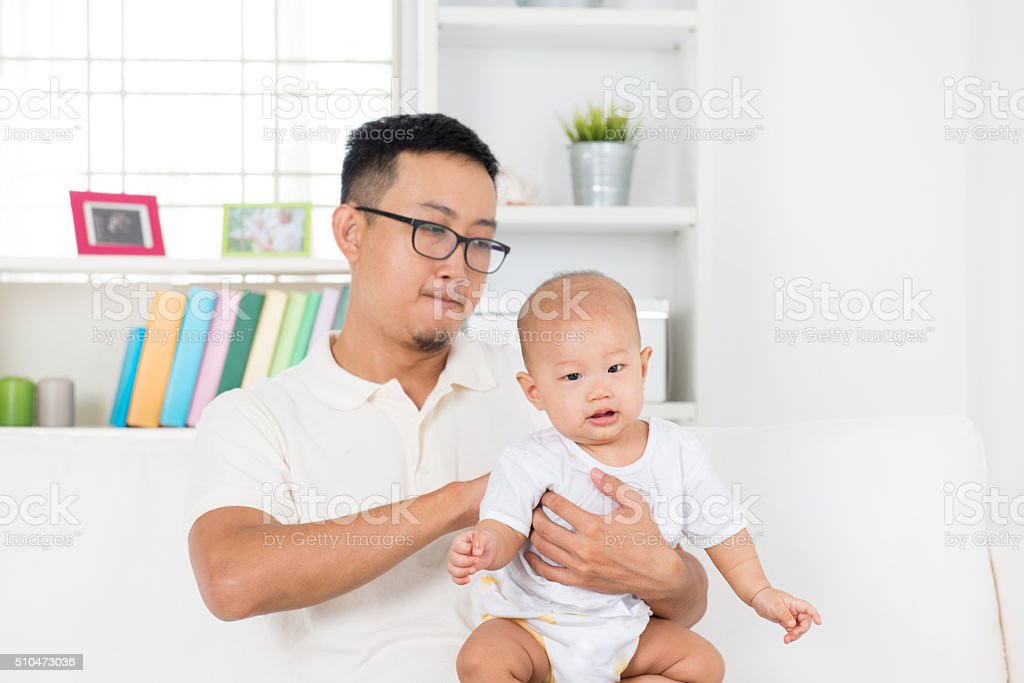 Father burping baby after meal stock photo