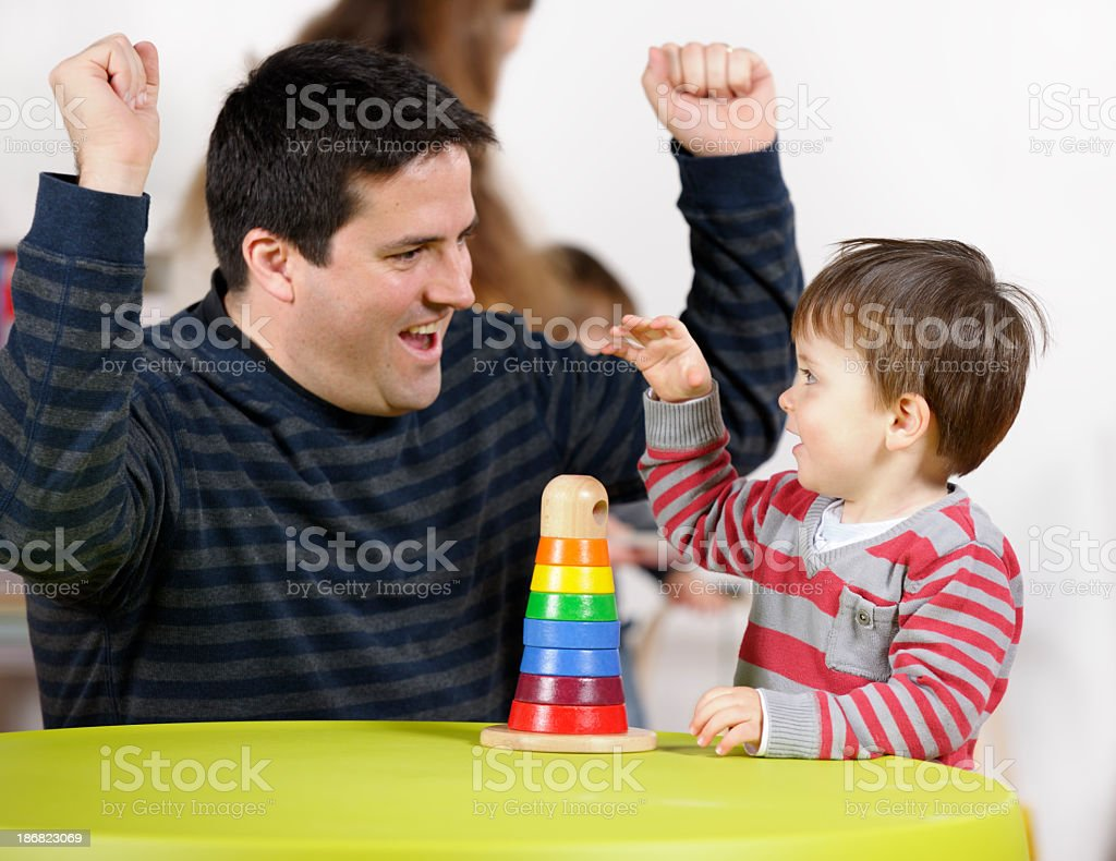 Father/ Carer Interacting With Toddler stock photo