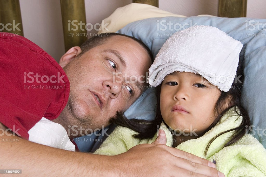 Father caring for sick daughter series royalty-free stock photo