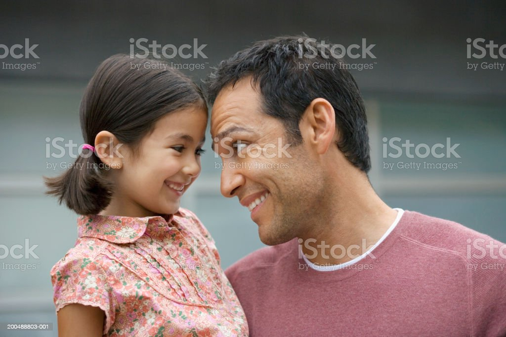 Father carrying daughter (5-7) outside house royalty-free stock photo