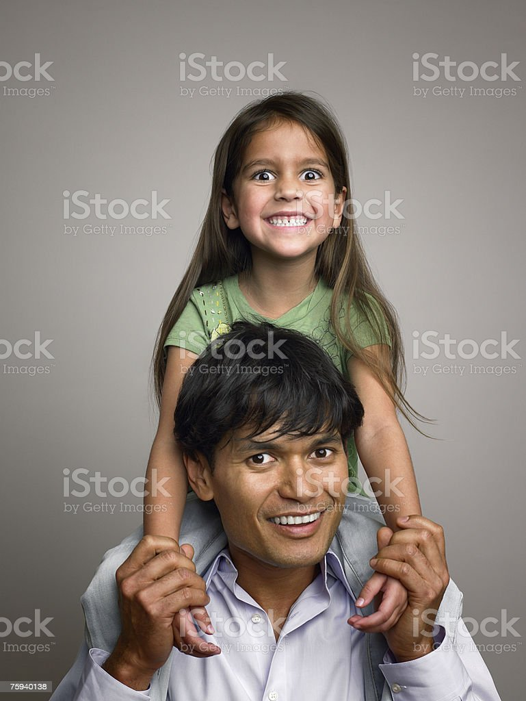 Father carrying daughter stock photo