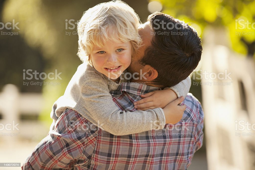 Father carrying son outdoors royalty-free stock photo