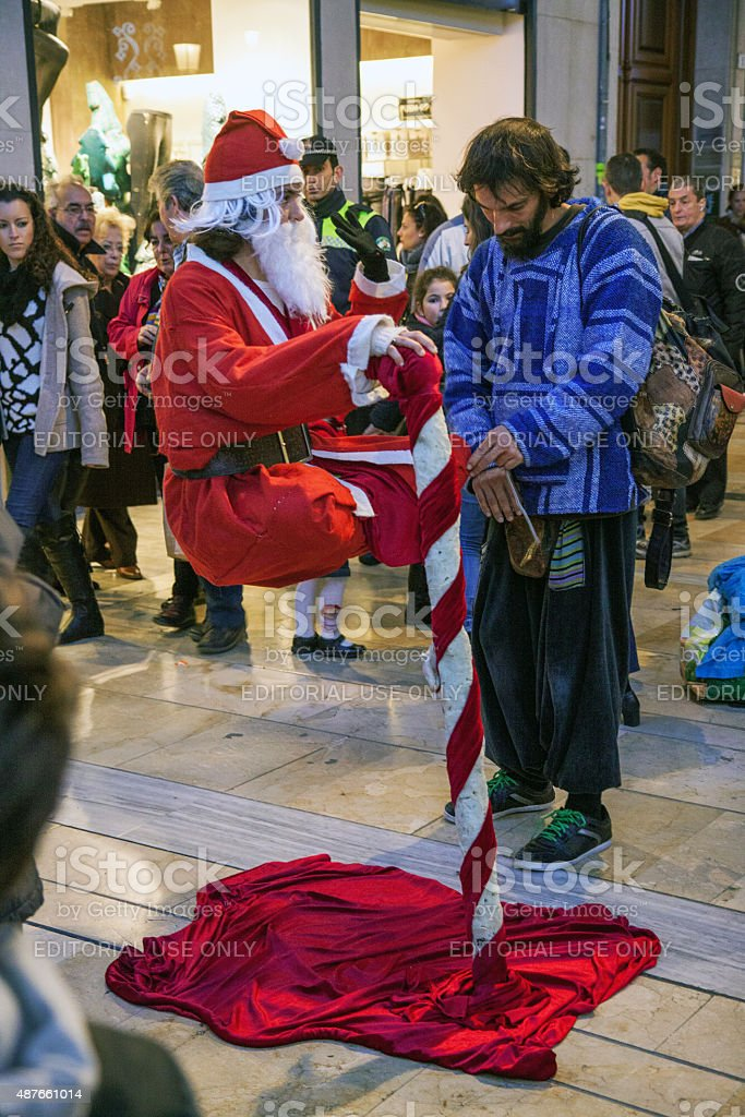 Father Christmas floating above Calle Marques Larios in Malaga stock photo