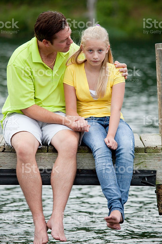 Father Comforting his girl on a Dock royalty-free stock photo
