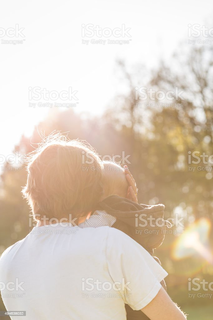 Father cradling his baby in his arms stock photo
