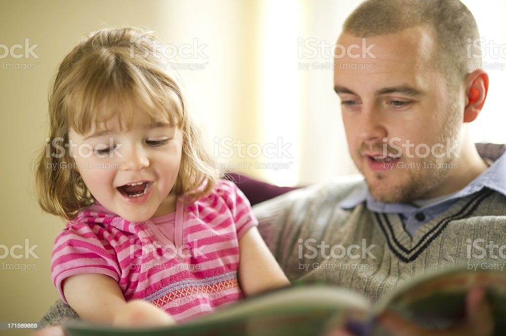 father daughter booktime royalty-free stock photo
