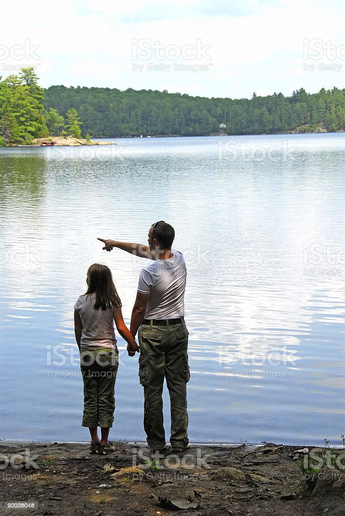 Father daughter lake royalty-free stock photo