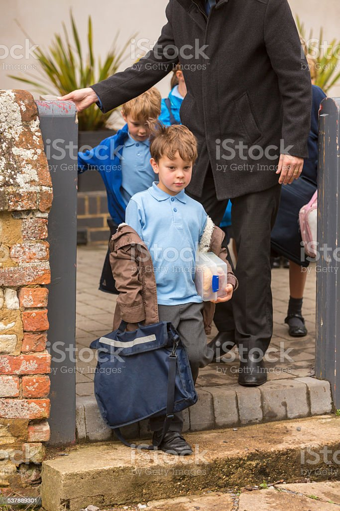 Father Dropping Child to School stock photo