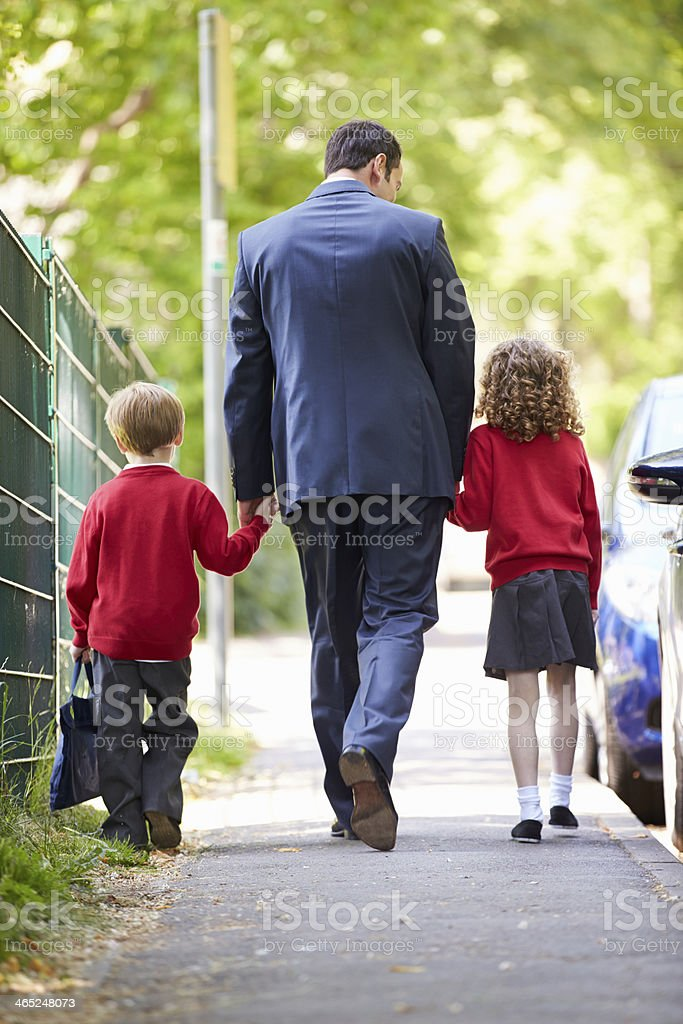 Father Dropping Kids Of At School On Way To Work stock photo