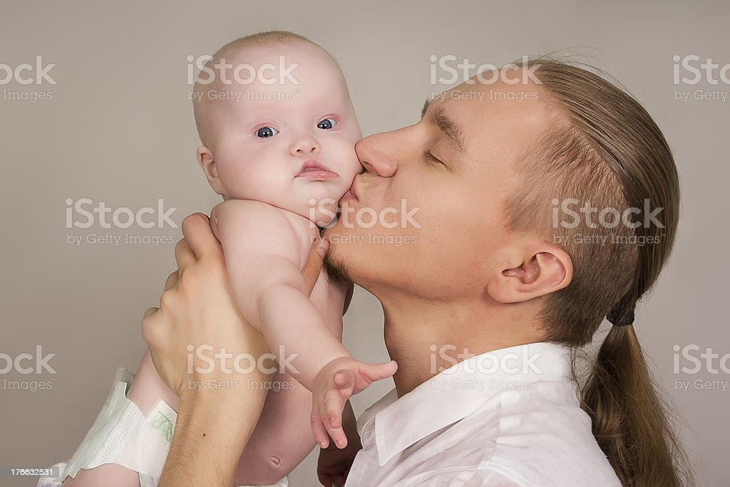 father embraces the newborn child and smiles royalty-free stock photo