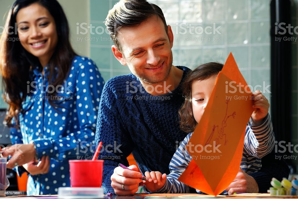 Father Enjoying Art And Craft With Son royalty-free stock photo