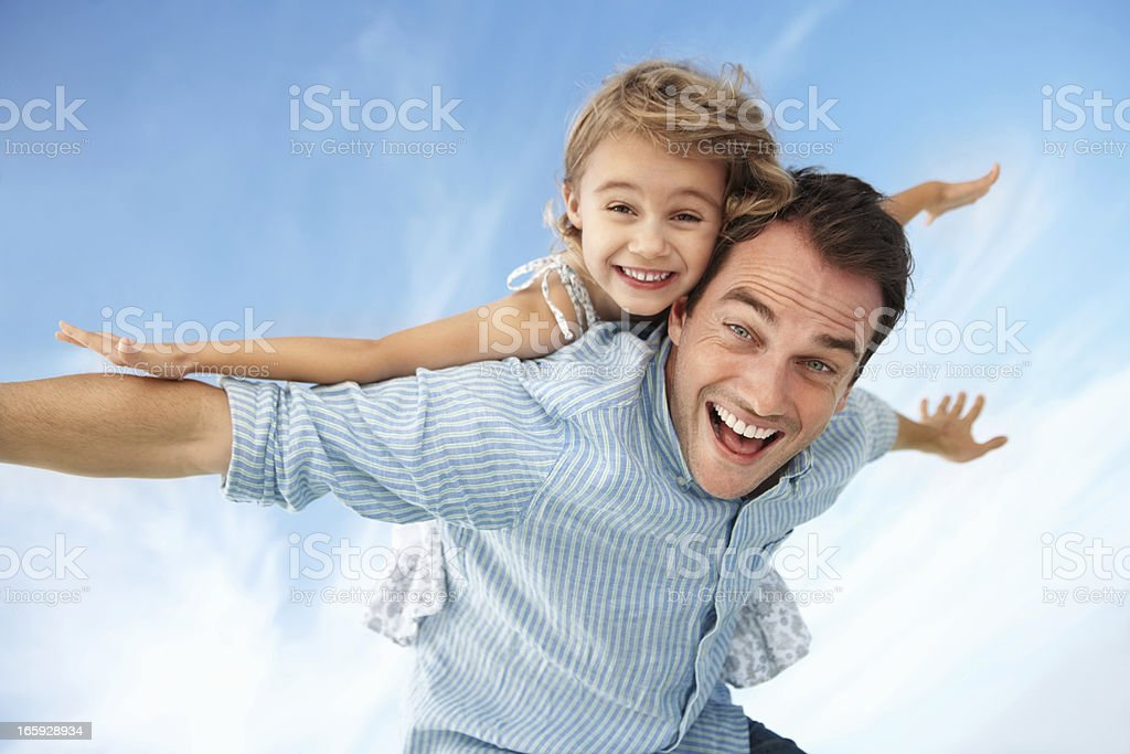 Father enjoying summer day with daughter royalty-free stock photo
