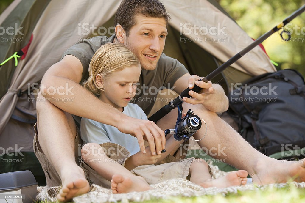 Father fishing with his son stock photo