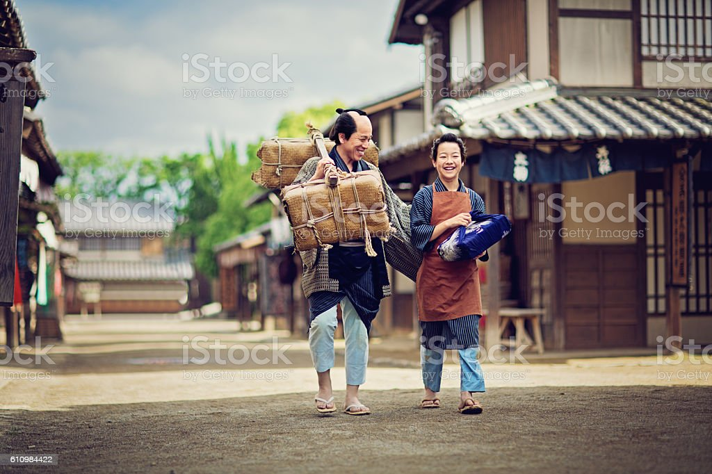 Father from edo period is talking with his son. stock photo