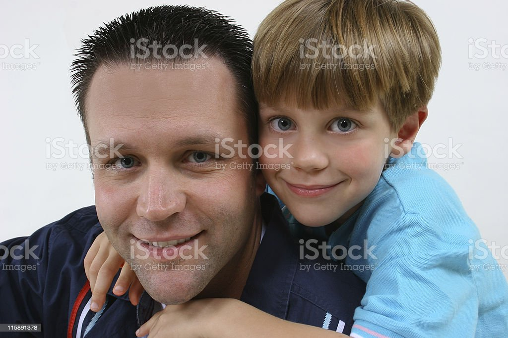 Father get a hug from his son for Father's Day royalty-free stock photo
