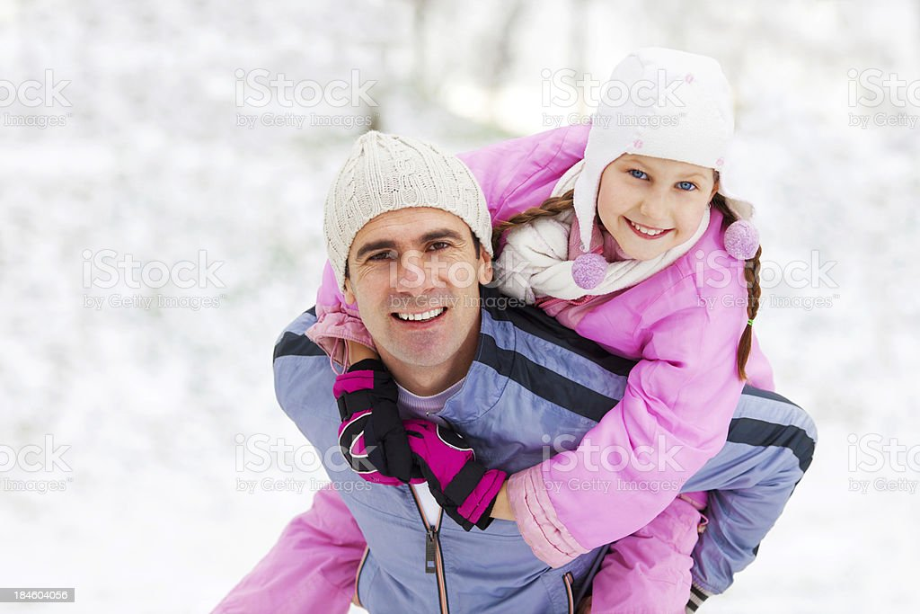Father giving his daughter a piggyback ride. royalty-free stock photo