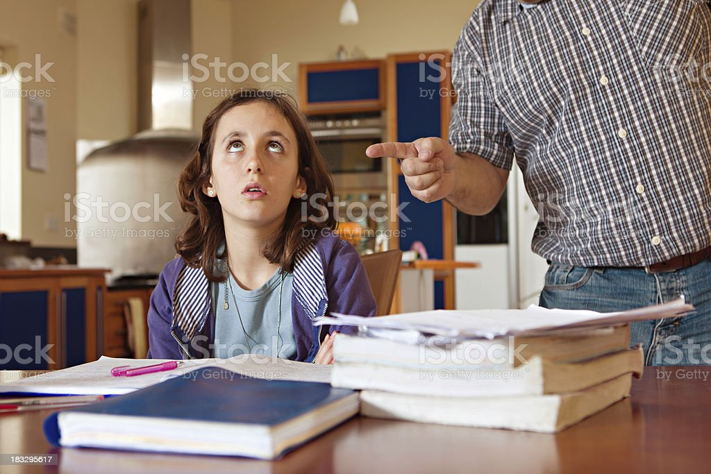 Father giving out to his daughter royalty-free stock photo