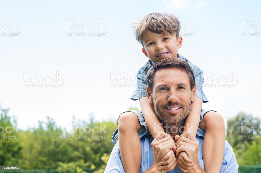 Father giving piggyback ride stock photo