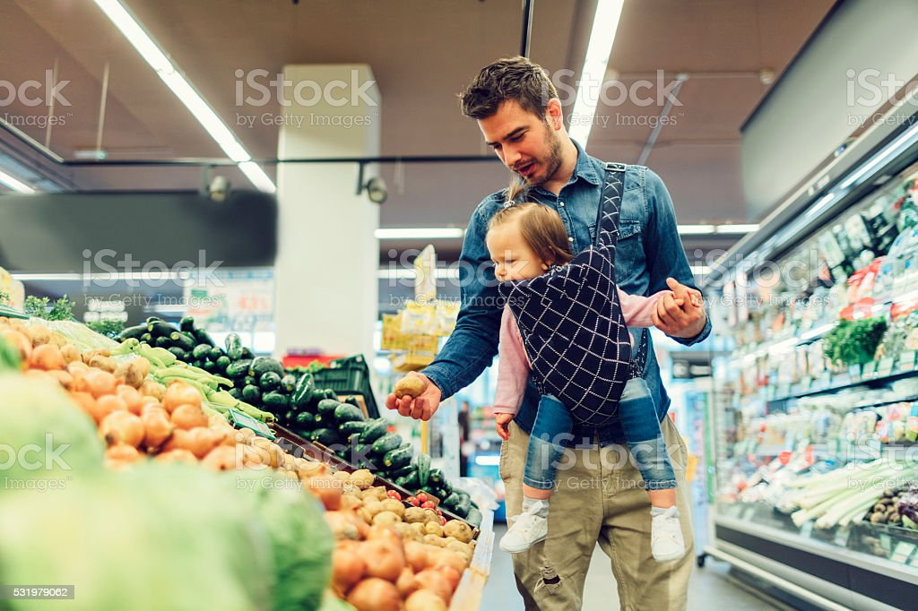 Father Grocery Shopping. stock photo