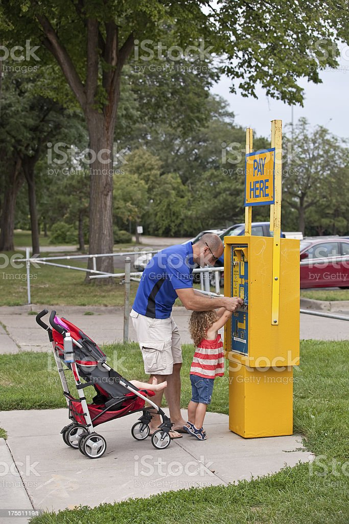 Father Helping Daughter Pay for Parking Ticket stock photo