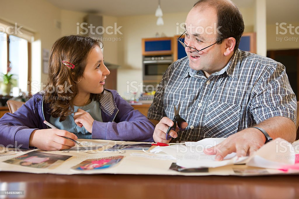 Father helping daughter with her homework royalty-free stock photo