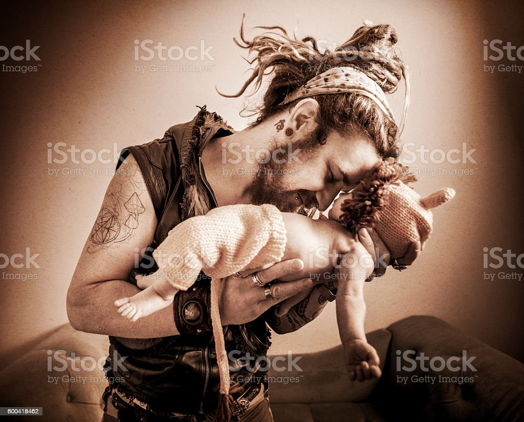 Father Holding His Baby Boy Wearing Lion Cub Costume stock photo