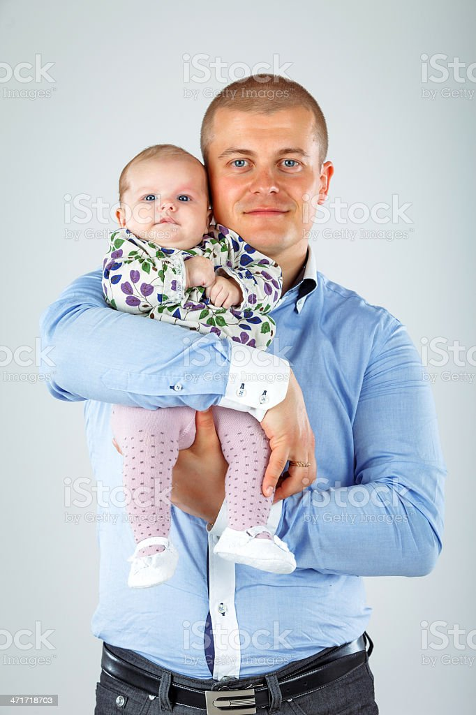 Father holding his baby girl royalty-free stock photo