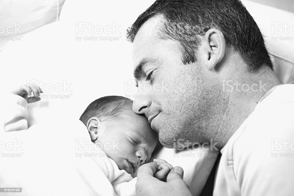 father holding his newborn baby royalty-free stock photo