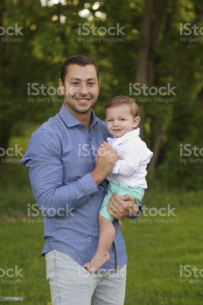 Father Holding His Son Outside royalty-free stock photo