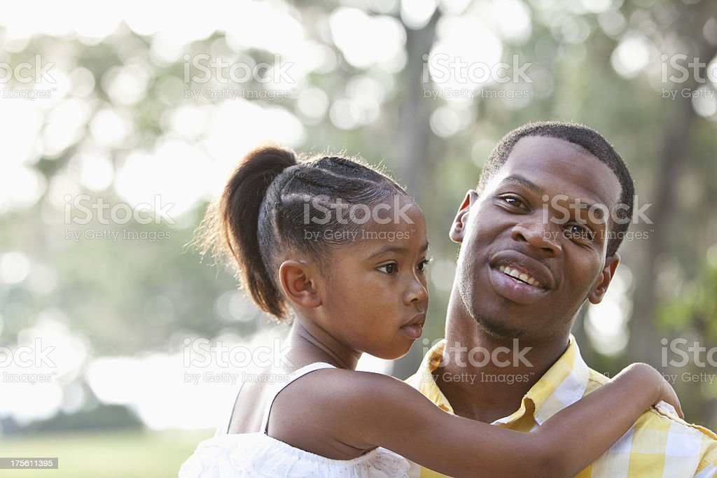 Father holding little girl royalty-free stock photo