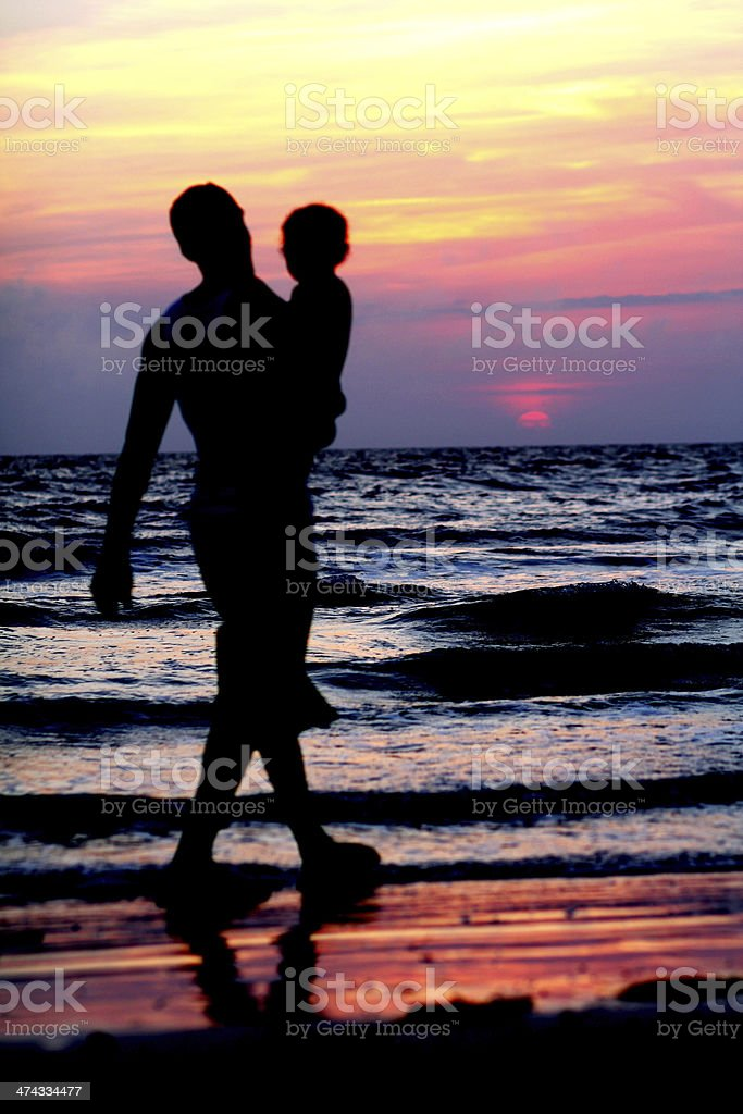 Father holding Son Silhouette royalty-free stock photo