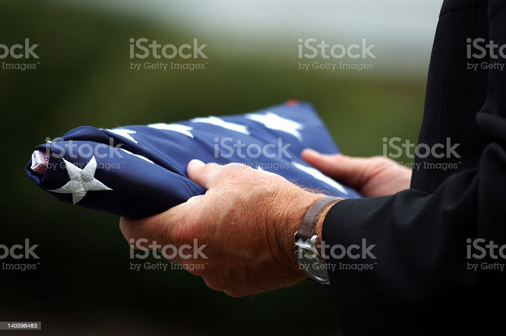 Father Holding Son's Flag stock photo