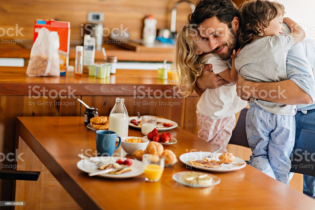 Father hugging children stock photo