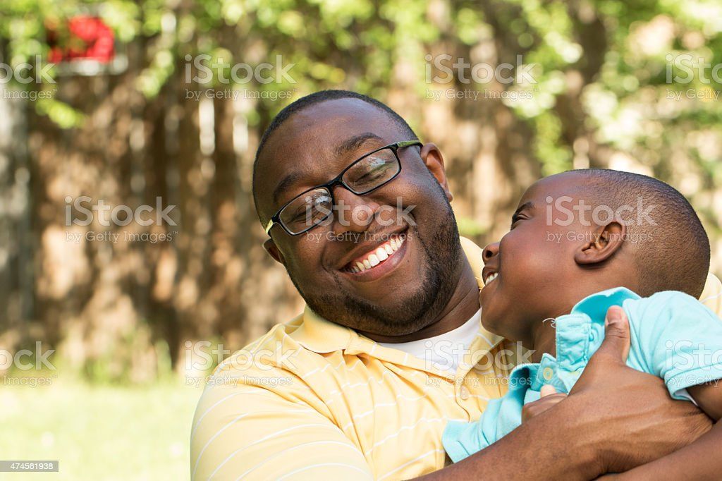 Father hugging his son stock photo